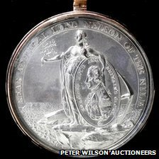 The obverse side of a Nile Medal